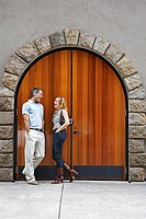 Mid Adult Couple Talking by Arched Door