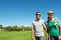 Mature couple looking at view in park