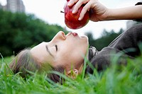 Woman kissing apple