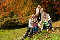 Portrait of multi-generation family and dog in woods (thumbnail)