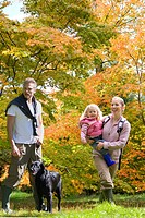 Family and dog walking in woods