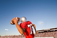 Quarterback throwing football