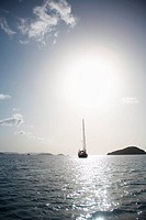 Sun over sailboat in sea, St. John, US Virgin Islands, USA