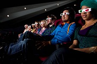Audience in cinema wearing 3D glasses, low angle view