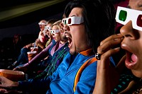 Audience in cinema wearing 3D glasses, close-up (thumbnail)