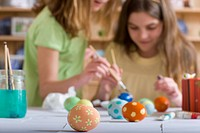 Young girls decorating Easter eggs