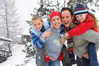 Portrait of happy family in winter setting