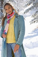 Portrait of young mixed race woman standing in snow