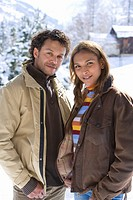 Portrait of mixed race couple standing in winter setting