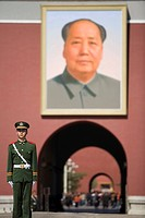 Portrait of Chairman Mao on the gateway with a guard at Tiananmen, Beijing, China