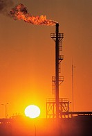 An oil refinery with gas flame