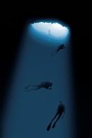 diver diving cave inside
