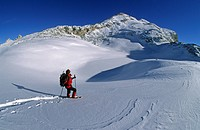Woman snowshoeing in front of Col Bechei Fanes area South Tyrol Dolomites Italy