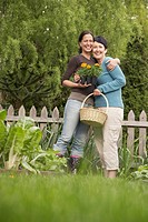 Two Women Hugging in Garden