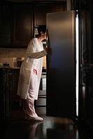 Woman Looking into a Refrigerator