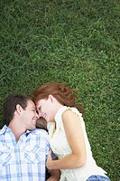 Couple Lying Down in the Grass