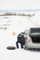 Changing a Tire in the Snow
