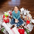 Girl Surrounded by Gifts