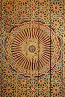 Fine colourful paintings at wooden ceiling Palais de la Bahia Marrakech Morocco