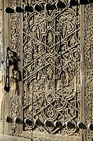 Decorative wood carving at an old wooden door in the Tash Hauli Palace in the old town Khiva Uzbekistan