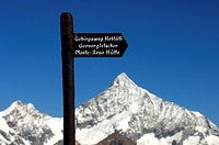 Hiking signpost in front of the Weisshorn, Zermatt Valais Switzerland