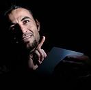 Portrait of a man, index finger