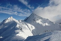 Foehn clouds over recently snowed up untouched winter landscape in the Zillertal alps Brandenberger Kolm Tyrol Austria