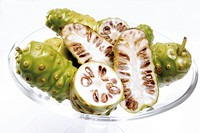 Fresh noni fruit in a cocktail glass