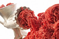 Fresh raw ground meat and a meat-grinder