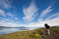 Photographer on an island in the Beagle Channel, Tierra del Fuego, Argentina, South America