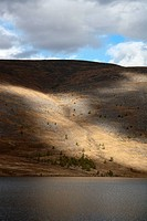 Afternoon light on hills surrounding Shireet Lake in Ovorkhangai Province, north central Mongolia This lake is one of the Khuisyn Naiman Nuur Khuisyn ...
