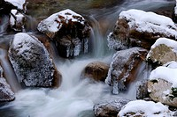 Ice-covered rocks in a mountain stream, Farchant, Upper Bavaria, Bavaria, Germany, Europe