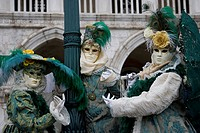 Green and beige costumes and masks, Carnevale di Venezia, Carneval in Venice, Italy