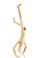 Jointed wooden mannequin doing a handstand