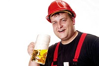 Construction worker wearing red hardhat holding a mug of beer