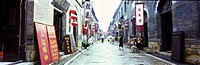 Tourist walking down the ancient business district of Zhou Cun, Zhou Cun, Shandong Province, China