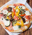 Vegetarian pizza topped with vegetables and mozzarella