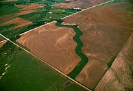 Agriculture _ Aerial view of fallow agricultural land with a grassy waterway bisecting the field / KS _ nr. Stockton