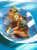 Smoked salmon and cucumber sandwiches in black bread