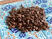 Roasted Coffee Beans on Mosaic Tile