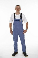 Workman wearing overalls and safety boots