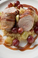 Pheasant breast with bacon, sauerkraut and grapes