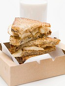 Toasted peanut butter & banana sandwiches, glass of milk