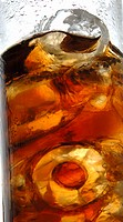 Glass of cola with ice cubes close_up