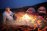 Camp in the Tengger desert, camel driver Ningxia China