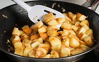 Fried potatoes with onions in a frying pan