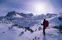 Snowshoe trekker reaching the 2995m Hoher Dachstein massif, Styria, Austria Europe