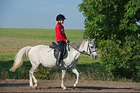 girl riding on German Riding Pony