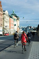 Sweden, Sodermanland, Stockholm, bicyclists riding on sidewalk