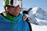Two skiers, snowboarders, close up, reflection, ski goggles, mountains in the back, St. Moritz, Diavolezza, Switzerland, Europe